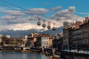 The Grenoble-Bastille cable car, the Drac river and the mountains in the background.